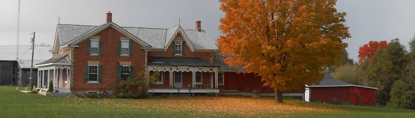 early ontario brick farmhouse with gingerbread trim